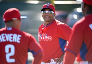 Marlon Byrd talks with teammates during workouts Friday in Clearwater.