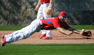 Kevin Frandsen dives for a ball Friday in Clearwater.