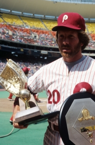 3B Mike Schmidt carries his 1980 Rawlings Gold Glove and MVP award.