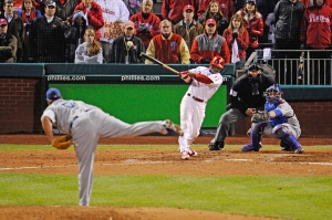 PHILADELPHIA - OCTOBER 19:  Jimmy Rollins #11 of the Philadelphia Phillies hits a game-winning walkoff 2-run double in the bottom of the ninth inning to win 5-4 against Jonathan Broxton #51 of the Los Angeles Dodgers in Game Four of the NLCS during the 2009 MLB Playoffs at Citizens Bank Park on October 19, 2009 in Philadelphia, Pennsylvania.  (Photo by Jeff Zelevansky/Getty Images) *** Local Caption *** Jimmy Rollins;Jonathan Broxton