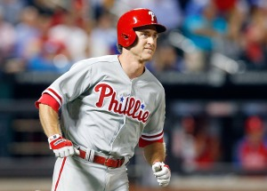 NEW YORK, NY - JULY 29:  Chase Utley #26 of the Philadelphia Phillies follows watches the flight of his seventh inning grand slam against the New York Mets at Citi Field on July 29, 2014 in the Flushing neighborhood of the Queens borough of New York City.  (Photo by Jim McIsaac/Getty Images)