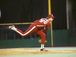 Larry Richard 'L.C.' Christenson (November 10, 1953 in Everett, Washington), is a former professional baseball pitcher who played his entire career for the Philadelphia Phillies from 1973-1983. Christenson made his major-league debut on April 13, 1973, and beat the New York Mets 7-1, pitching a complete game. At the time, he was the youngest player in the Major Leagues at 19; he would remain so until 18-year-old David Clyde debuted for the Texas Rangers on June 27 of that same season. He would bounce back and forth from the majors to the minor leagues until 1975, when the Phillies called him up to stay. Christenson went 11-6 that season and would become a key cog on the Phillies' teams that would win three straight National League Eastern Division titles from 1976 to 1978. He would have his best seasons those three years, going 13-8 with a 3.68 earned run average in 1976. His best season was 1977, when he went 19-6 with a 4.06 ERA, winning 15 of his last 16 decisions. He slipped to 13-14 in 1978, despite posting a career-best ERA of 3.24, and started Game 1 of the 1978 National League Championship Series. Then, injuries would begin to plague Christenson's career. He began the 1979 season on the disabled list with elbow problems and missed the first month. Then, in June of that season, he broke his collarbone during a charity bicycle ride and missed several weeks. He ended up with a 5-10 record that season. In 1980, he started 3-0, but went on the disabled list again and had elbow surgery. He recovered to finish the season 5-1 and start Game 4 of the 1980 World Series, but was knocked in the first inning. In 1981, Christenson posted a less-than-stellar 4-7 record, but posted a win in the 1981 National League Division Series against the Montreal Expos. His last injury-free season was 1982, when he made 32 starts and went 9-10. In 1983, Christenson went under the knife for elbow surgery for the final time after a 2-4 start. He failed to make the postseason roster a