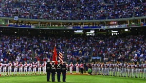 With a Marine Corps color guard, Atlanta Braves and Philadelphia Phillies line the foul lines for ceremonies before the start of their game Monday, Sept. 17, 2001 in Philadelphia. (AP Photo)